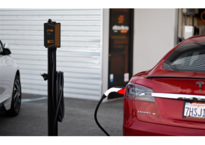 JuiceBox Pedestal charging a Tesla